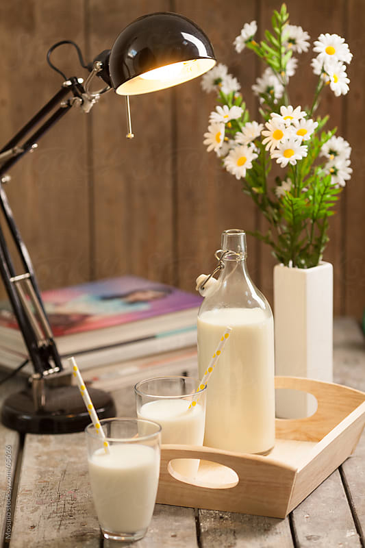 Milk and Flowers on the Desk by Mosuno for Stocksy United