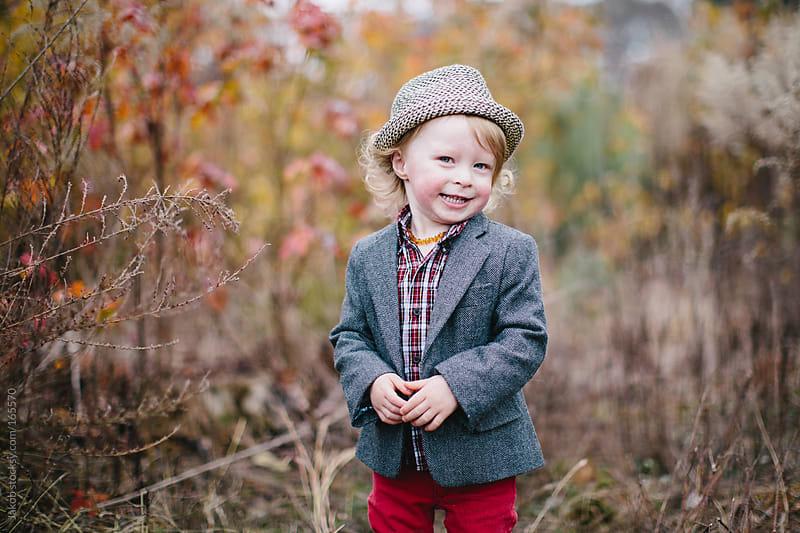 Portrait of a cute boy in a blazer wearing a fedora hat by Jakob for Stocksy United