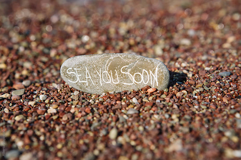 A funny message in a stone by Alberto Bogo for Stocksy United