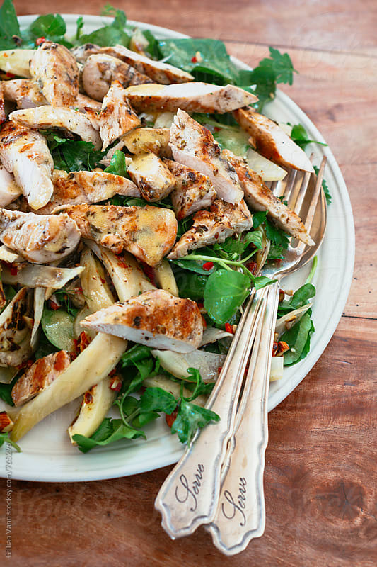 delicious chicken and artichoke salad, with vintage salad servers by Gillian Vann for Stocksy United