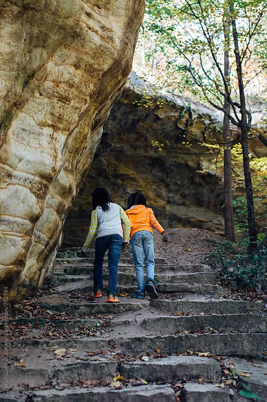 Two black girls on a nature hike by Gabriel (Gabi) Bucataru for Stocksy United