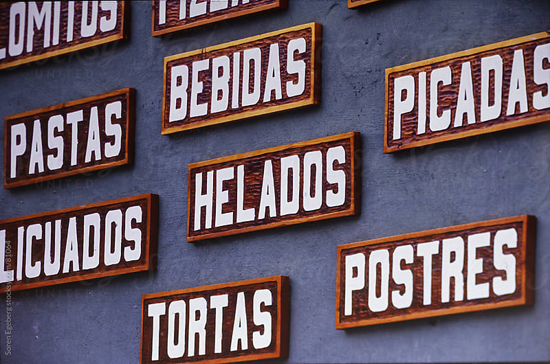 Restaurant sign with South american food and dishes by Soren Egeberg for Stocksy United