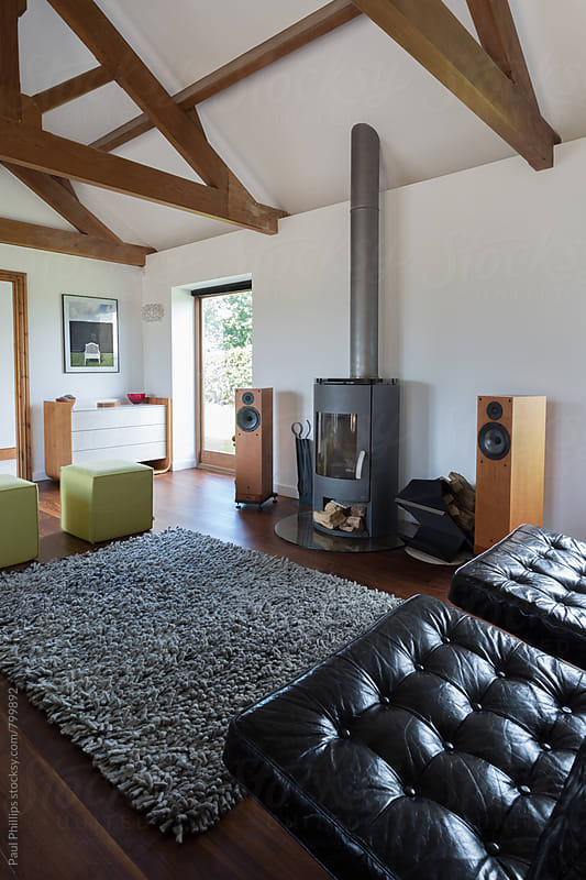 Contemporary living room in a converted barn by Paul Phillips for Stocksy United