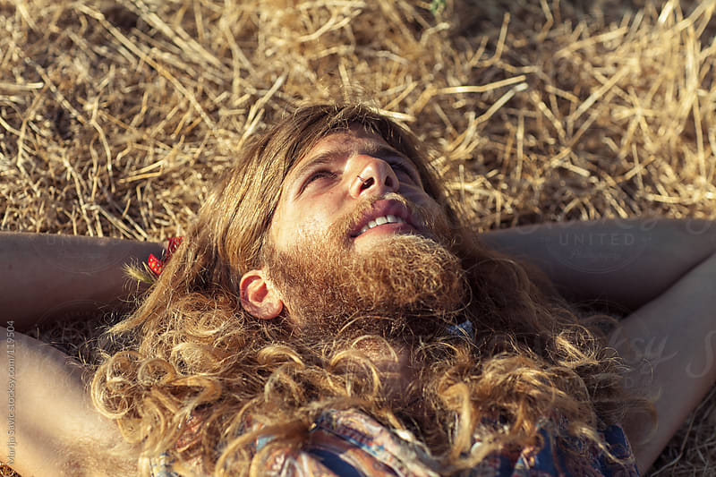 Young hippie daydreaming. by Marija Savic for Stocksy United