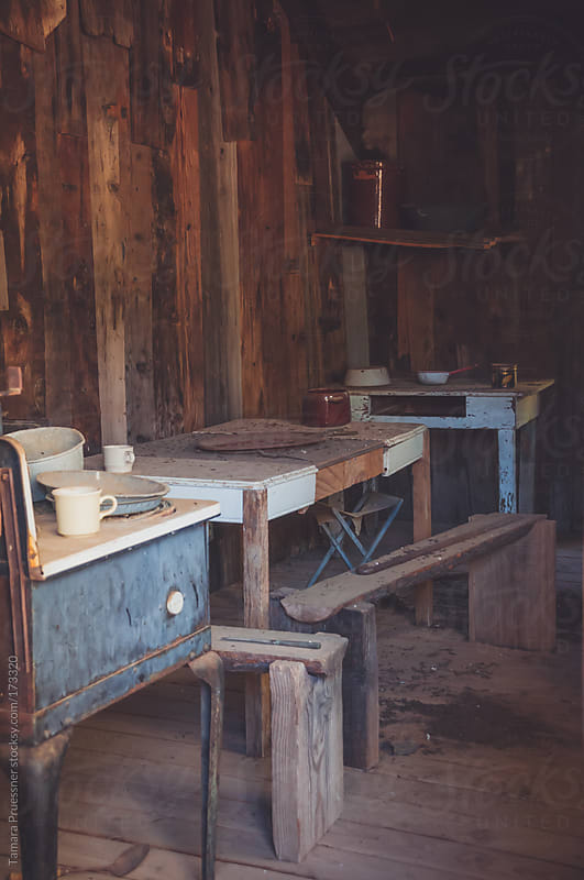 Interior View Of Rough Antique Kitchen by Tamara Pruessner for Stocksy United