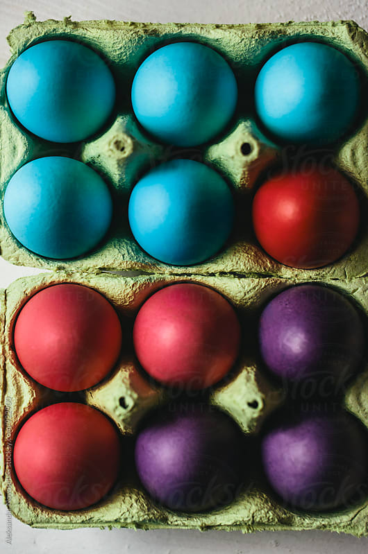 Colored Easter eggs in carton by Aleksandar Novoselski for Stocksy United