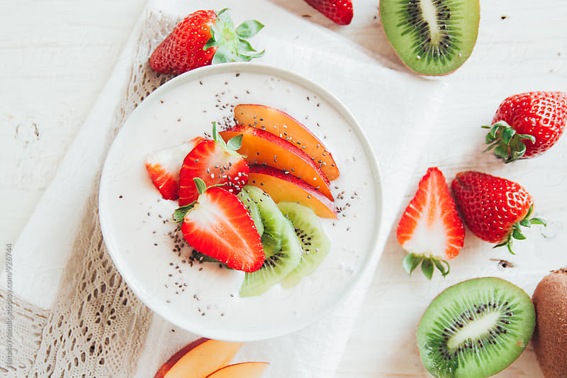 Breakfast smoothie bowl with fresh fruit by Nataša Mandić for Stocksy United