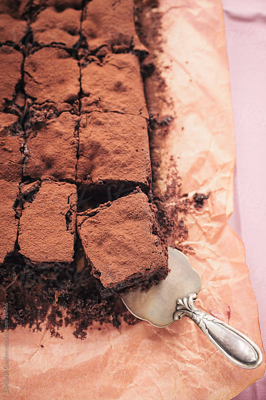 Moist brownies with prunes that have been soaked in cognac by Elisabeth Coelfen for Stocksy United