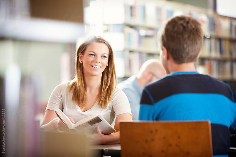 Library: Teens Working as a Team on Homework by Sean Locke for Stocksy United