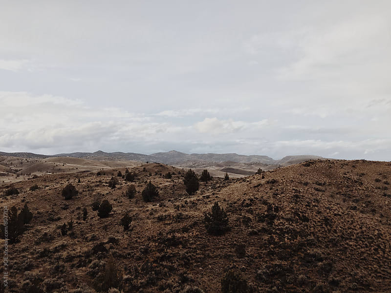 View of a hilly landscape in the desert by KATIE + JOE for Stocksy United