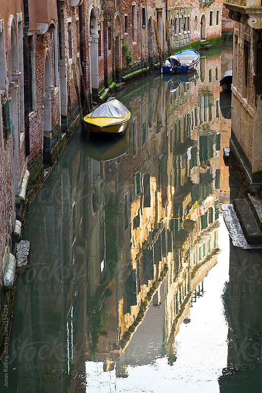 House reflection in the channel in Venice, Italy by Jonas Räfling for Stocksy United
