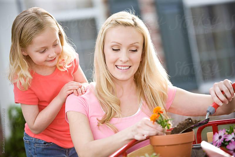 Planting: Watching Mom Transplant Flowers by Sean Locke for Stocksy United