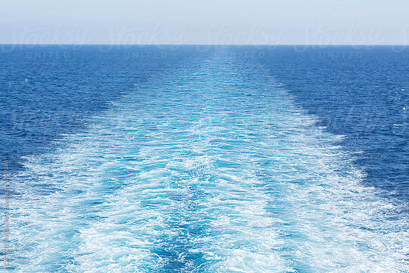 Water wake of a ferry boat in the sea by Blai Baules for Stocksy United