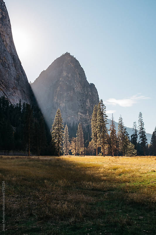 amazing valley with mountains and golden light  by Jesse Morrow for Stocksy United