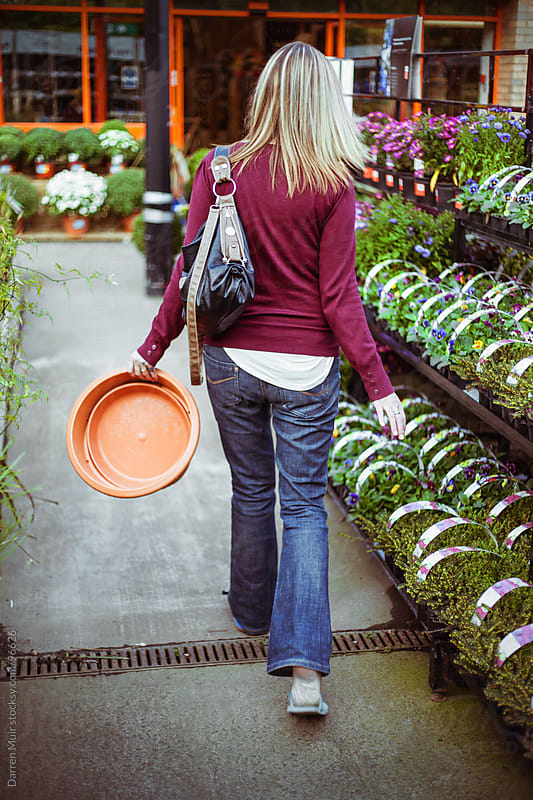 Woman shopping at garden centre.  by Darren Muir for Stocksy United