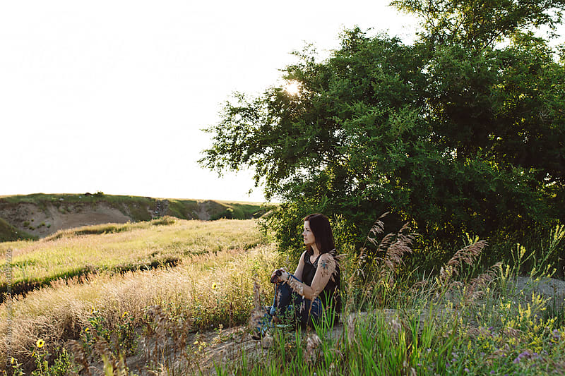 Beautiful Metis woman enjoying the summer landscape by Carey Shaw for Stocksy United