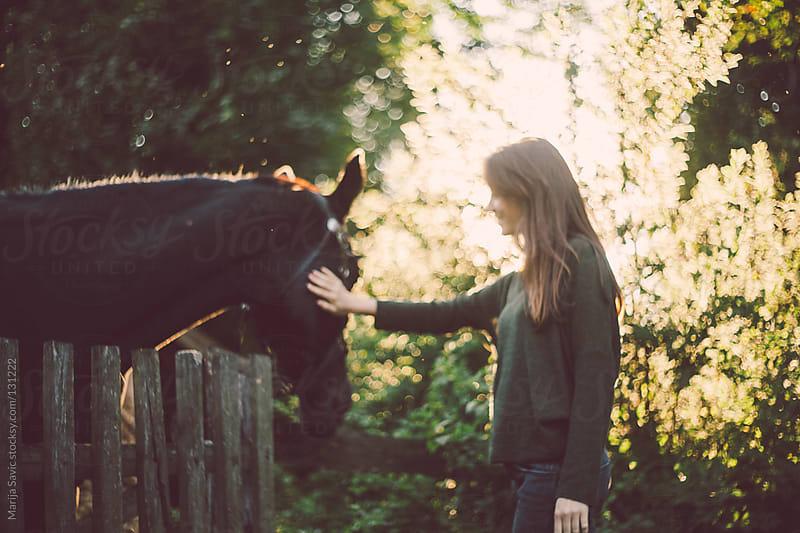 Woman Petting the Horse.  by Marija Savic for Stocksy United