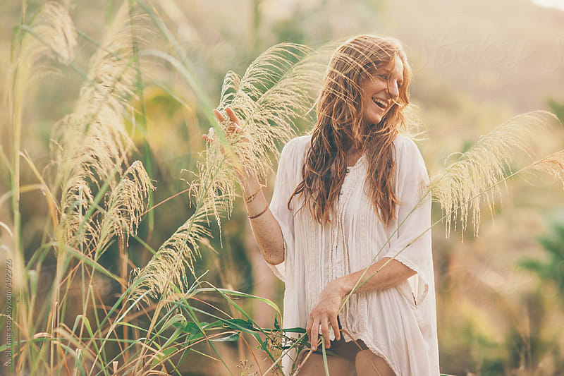 Portrait of a beautiful young woman in field by Nabi Tang for Stocksy United