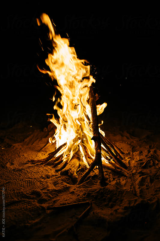 Fire on the beach at night by KATIE + JOE for Stocksy United