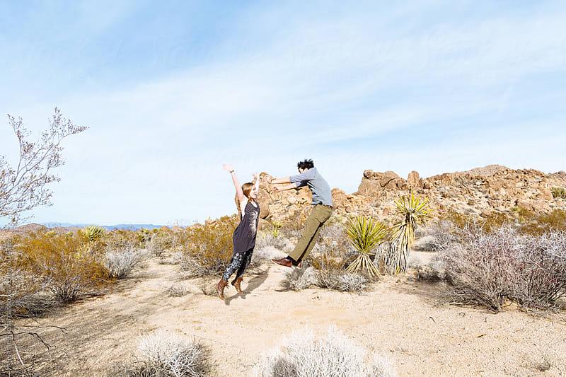 People having fun in the desert by Melanie Riccardi for Stocksy United