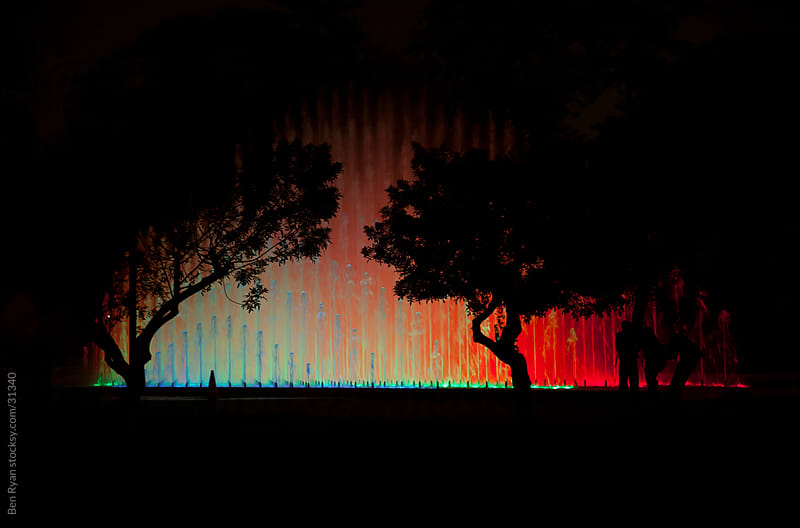 Rainbow water fountain at night by Ben Ryan for Stocksy United
