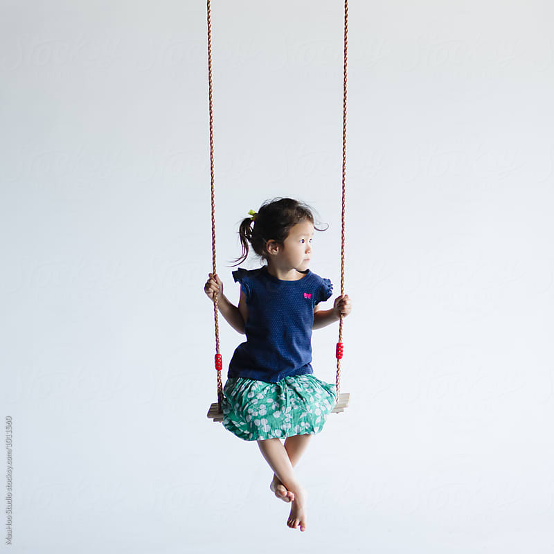 Cute little girl sitting on the swing by Maa Hoo for Stocksy United