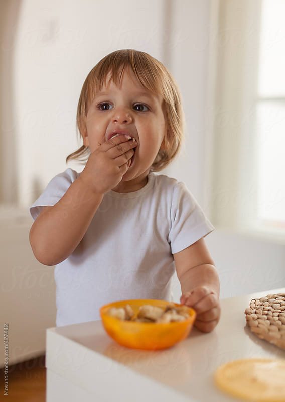 Cute Little Boy Eating With His Hands by Mosuno for Stocksy United