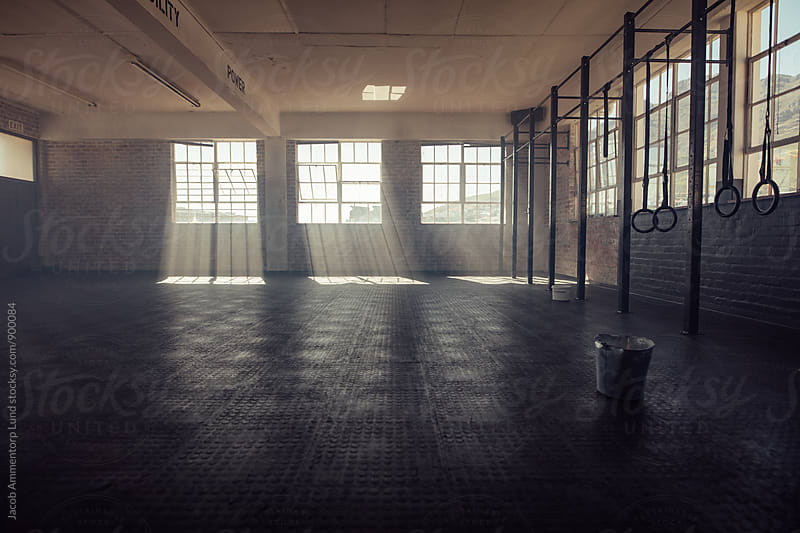 Empty fitness gym studio by Jacob Lund for Stocksy United