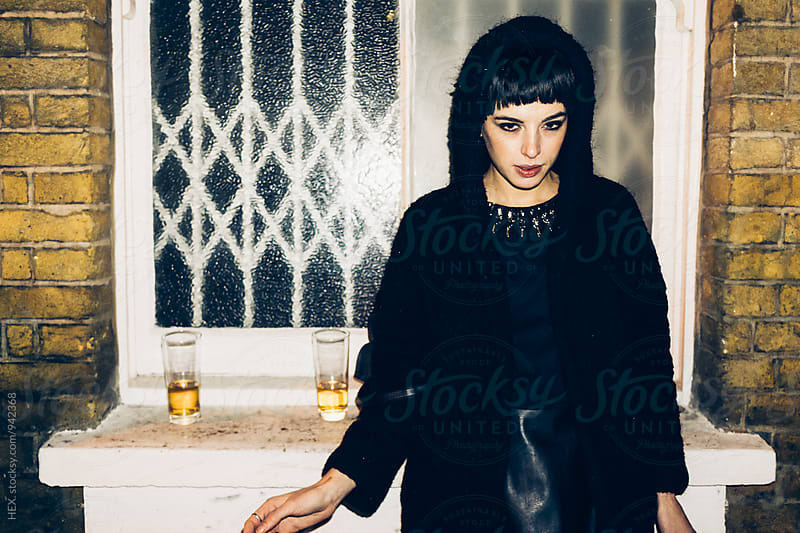 Young Beautiful Woman Smoking a Cigarette out of a Pub in London Uk by HEX. for Stocksy United