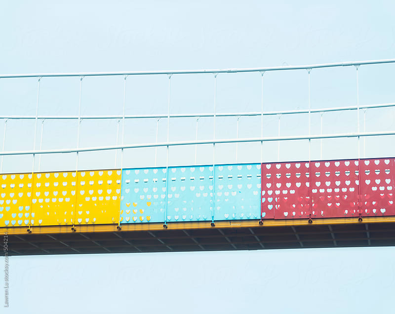 Colorful metal viaduct of yellow, blue and red by Lawren Lu for Stocksy United