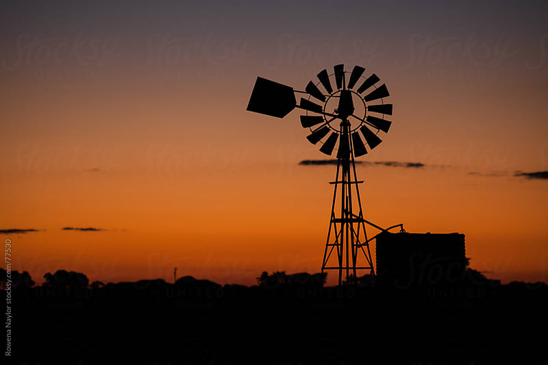 Old Farm Windmill at Sunset by Rowena Naylor for Stocksy United