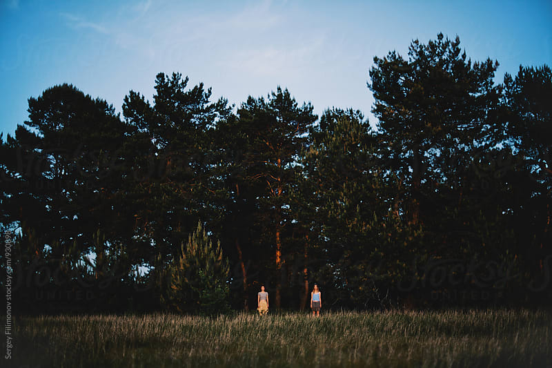 Two girl standing in the forest by Sergey Filimonov for Stocksy United