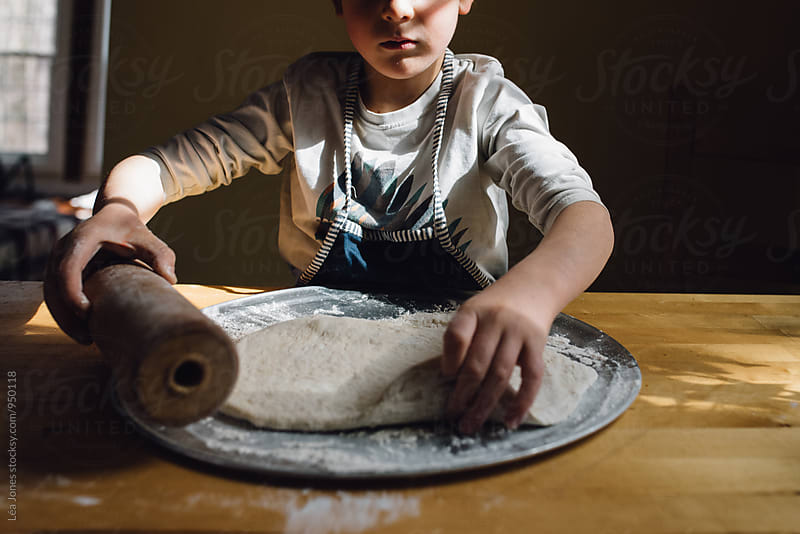 child making pizza by Léa Jones for Stocksy United