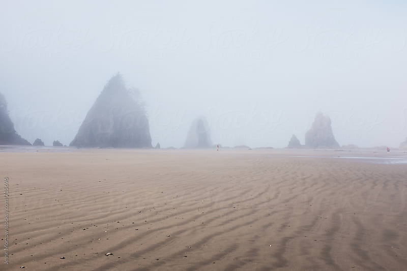 waves in sand on beach with beautiful rock formations  west coast usa by Jesse Morrow for Stocksy United