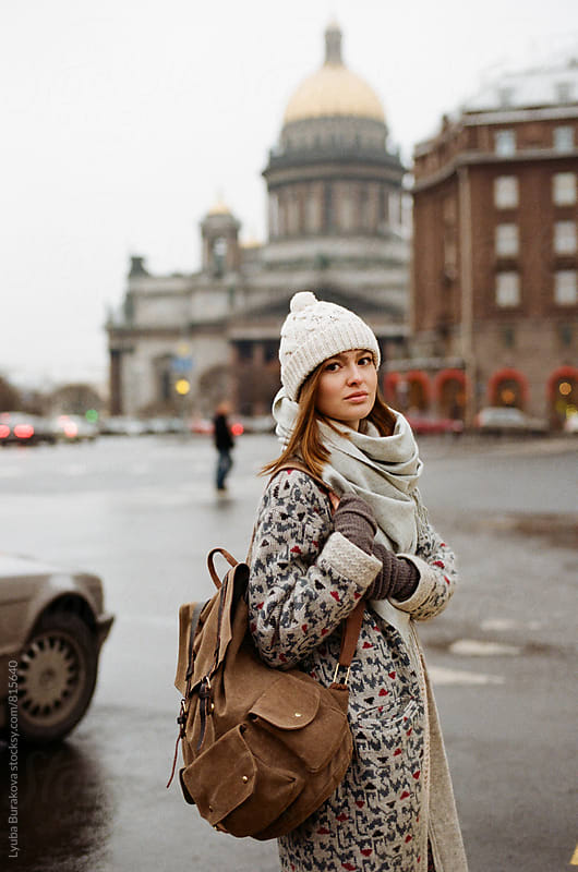 Young woman at front of Saint Isaac Cathedral in winter by Lyuba Burakova for Stocksy United
