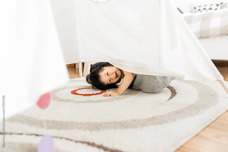 Cute toddler girl playing in tent by Maa Hoo for Stocksy United