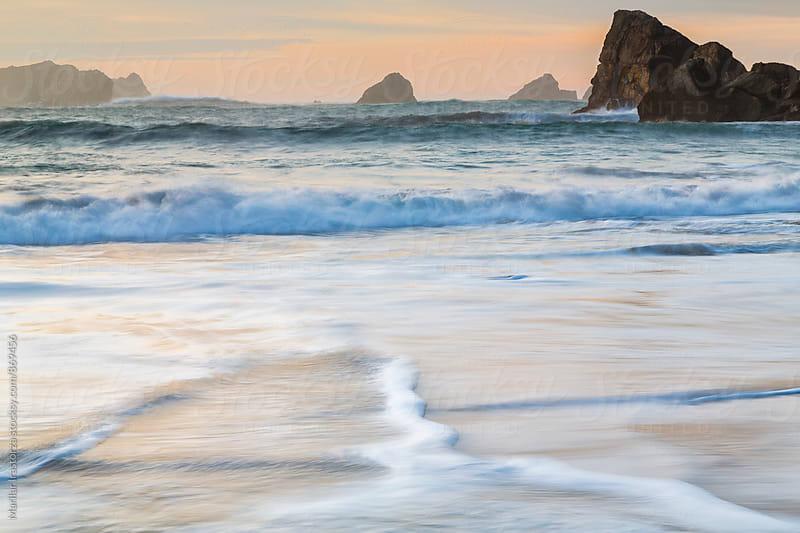 Big waves crashing with a misty sunset by Marilar Irastorza for Stocksy United