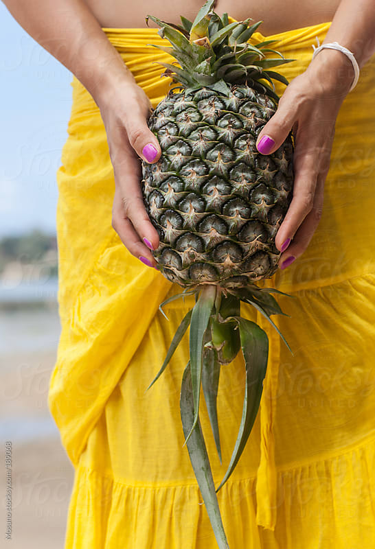 Woman Dressed in Yellow Holding Pineapple by Mosuno for Stocksy United