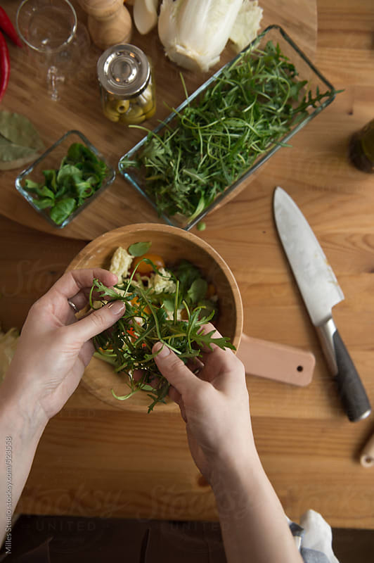 Woman hands cooking salad by Milles Studio for Stocksy United