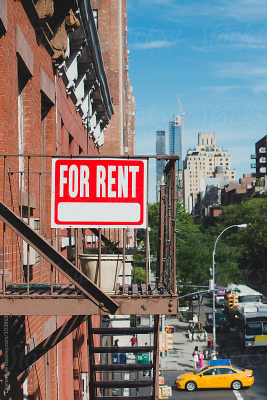 For rent sign on apartment building in the city by Lauren Naefe for Stocksy United