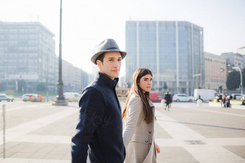 Beautiful couple walking along the city by michela ravasio for Stocksy United