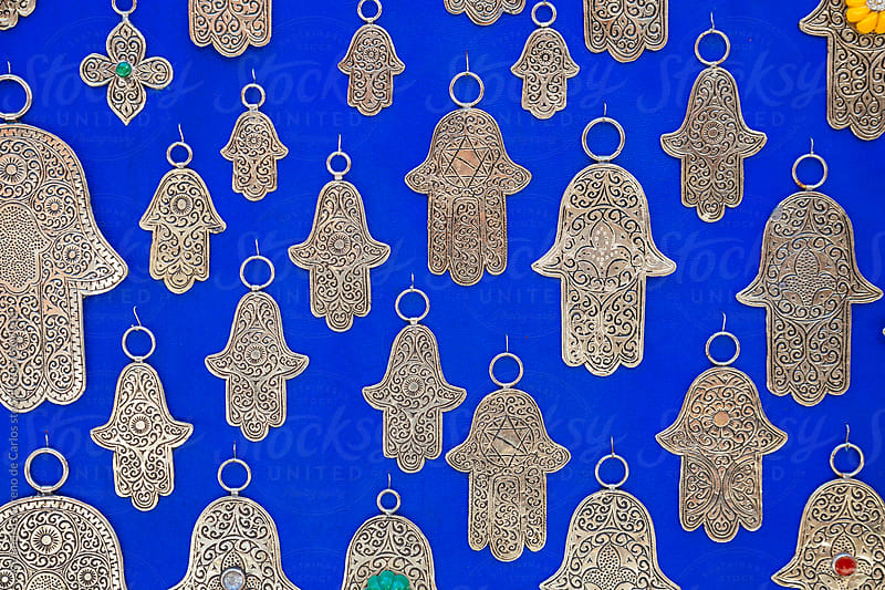 Hamsa or Fatima hands jewelry assortment in a souk market by Alejandro Moreno de Carlos for Stocksy United