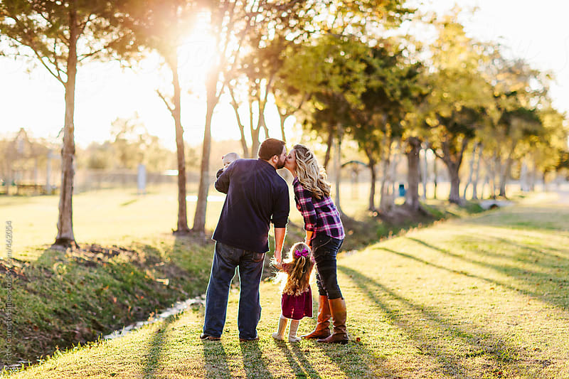Beautiful family enjoying their time at the local park.  by Kristen Curette Hines for Stocksy United