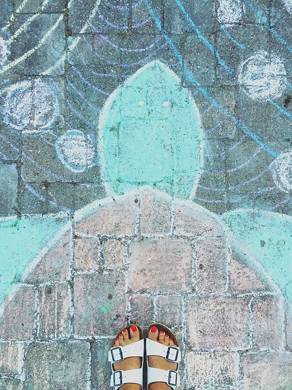 A woman feet looking down on a chalk drawing of a turtle. by Chelsea Victoria for Stocksy United