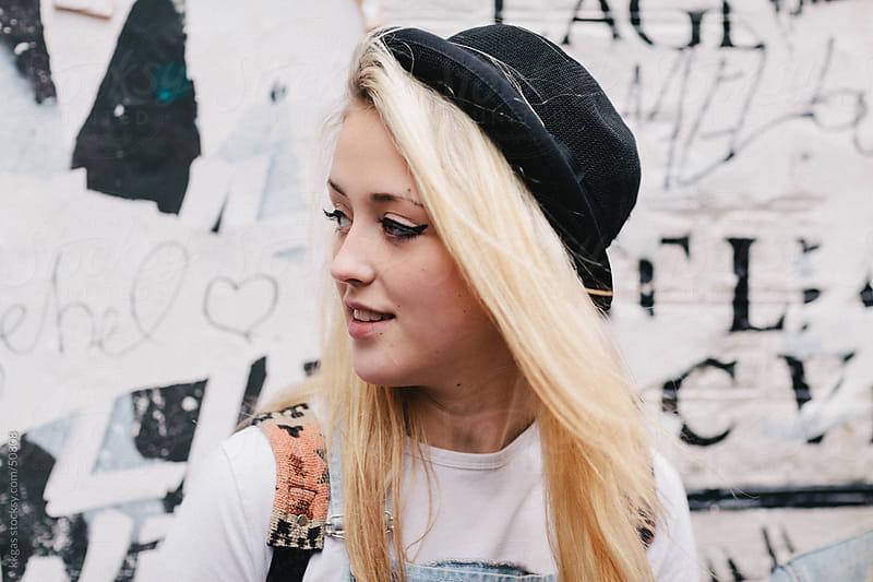 Pretty teenage girl wearing hat. by kkgas for Stocksy United