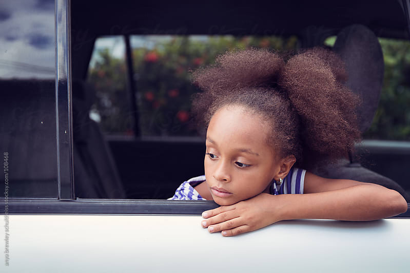 Girl looking out of a car window by anya brewley schultheiss for Stocksy United