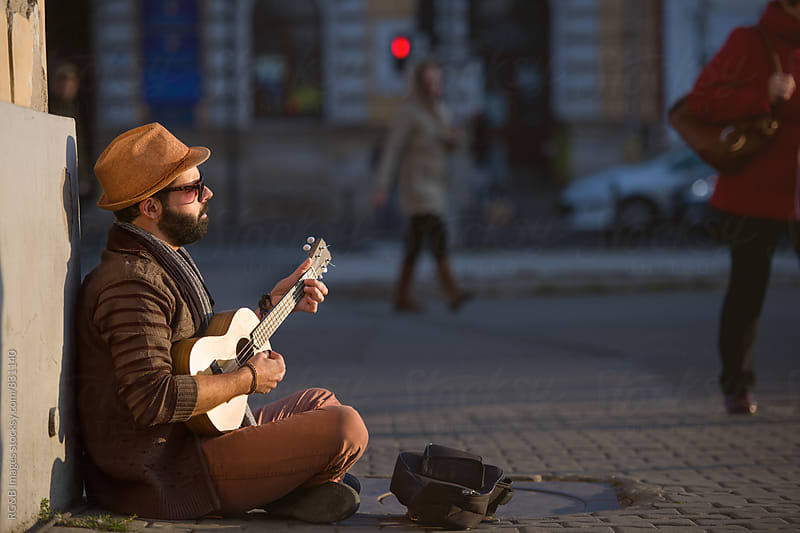 Musician playing ukulele on the street by RG&B Images for Stocksy United