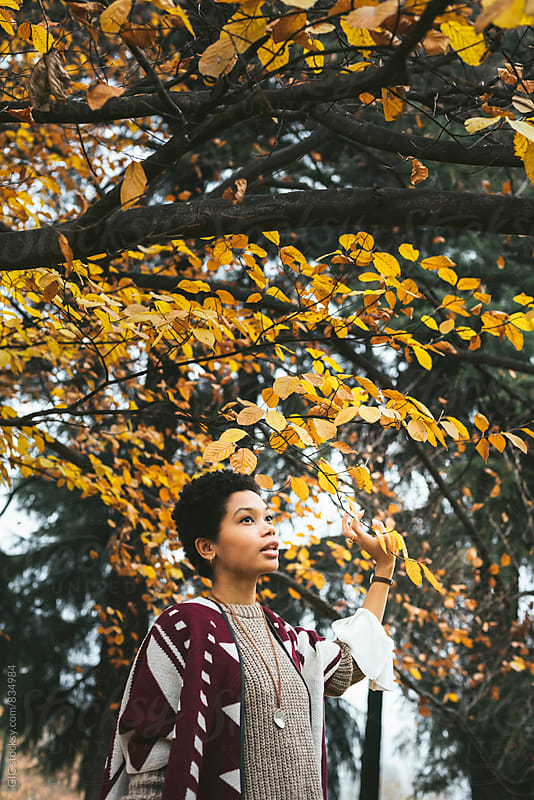 Young woman in the forest during autumn by Simone Becchetti for Stocksy United