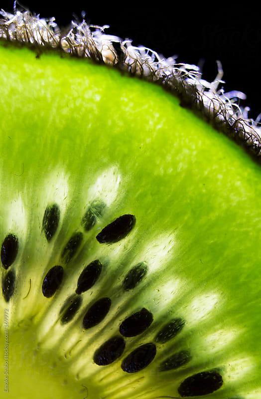 Close up of sliced kiwi by Emoke Szabo for Stocksy United
