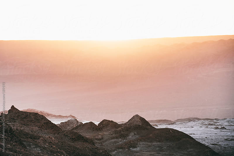 Soft focus Sunset light on desert landscape by Alejandro Moreno de Carlos for Stocksy United